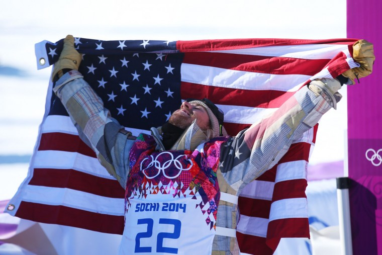 Sage Kotsenburg of the United States celebrates winning gold after his second run during the Snowboard Men's Slopestyle Final during day 1 of the Sochi 2014 Winter Olympics at Rosa Khutor Extreme Park on February 8, 2014 in Sochi, Russia. (Photo by Julian Finney/Getty Images)