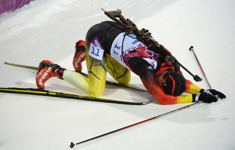 Christoph Stephan of Germany lies on the ground after crossing the finish line in the Men's Sprint 10 km during day one of the Sochi 2014 Winter Olympics at Laura Cross-country Ski & Biathlon Center on February 8, 2014 in Sochi, Russia. (Photo by Harry How/Getty Images)