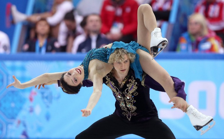 Meryl Davis and Charlie White of the United States compete in the team ice dancing free program during the Sochi 2014 Winter Olympics in Sochi, Russia. (Matthew Stockman/Getty Images)