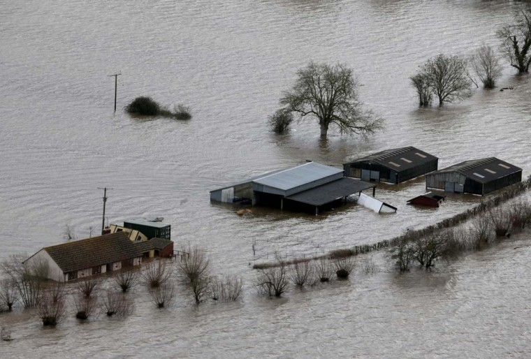 Flood surrounds a property in Moorland on the Somerset Levels near Bridgwater on February 10, 2014 in Somerset, England. Thousands of acres of the Somerset Levels have been under water for weeks, yet flood levels are still rising and worryingly, more rain is forecast for later this week. (Matt Cardy/Getty Images)