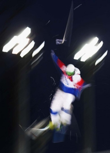 Sergey Volkov of Russia loses his pole as he jumps during the Men's Moguls Qualification on day three of the Sochi 2014 Winter Olympics at Rosa Khutor Extreme Park on February 10, 2014 in Sochi, Russia. (Ryan Pierse/Getty Images)