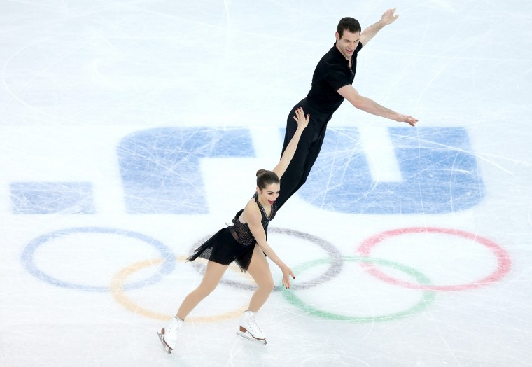 Marissa Castelli and Simon Shnapir of the United States compete during the Figure Skating Pairs Short Program on day four of the Sochi 2014 Winter Olympics at Iceberg Skating Palace on February 11, 2014 in Sochi, Russia. (Photo by Matthew Stockman/Getty Images)