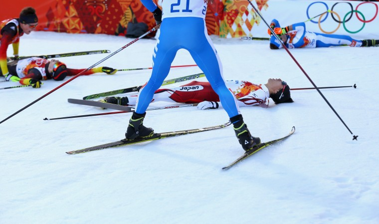 Akito Watabe (R) of Japan and Eric Frenzel (L) of Germany fall to the ground after the Nordic Combined Individual NH / 10 km during day five of the Sochi 2014 Winter Olympics at RusSki Gorki Jumping Center on February 12, 2014 in Sochi, Russia. (Photo by Ryan Pierse/Getty Images)