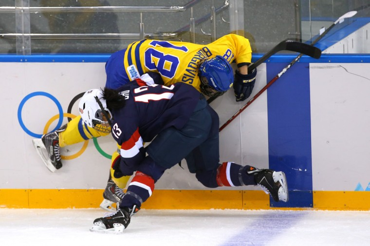 Julie Chu of the United States collides with Anna Borgqvist of Sweden in the first period during a women's ice hockey semifinal game at the Sochi 2014 Winter Olympics at Shayba Arena on February 17, 2014 in Sochi, Russia. (Doug Pensinger/Getty Images)