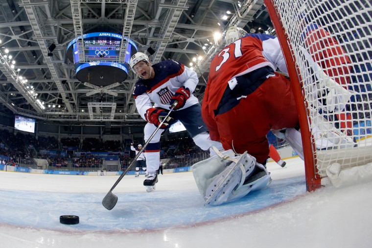 David Backes #42 of the United States scores his team's third goal in the first period against Ondrej Pavelec #31 of the Czech Republic during the Men's Ice Hockey Quarterfinal Playoff on Day 12 of the 2014 Sochi Winter Olympics at Shayba Arena on February 19, 2014 in Sochi, Russia. (Photo by Pool/Getty Images)
