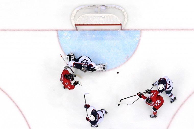 Jamie Benn #22 of Canada shoots and scores against Brooks Orpik #44 and Jonathan Quick #32 of the United States in the second period during the Men's Ice Hockey Semifinal Playoff on Day 14 of the 2014 Sochi Winter Olympics at Bolshoy Ice Dome on February 21, 2014 in Sochi, Russia. (Photo by Martin Rose/Getty Images)