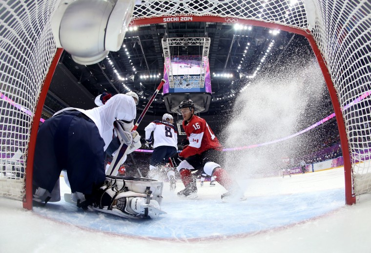 Jonathan Quick #32 of the United States makes a save against Jonathan Toews #16 of Canada in the first period during the Men's Ice Hockey Semifinal Playoff on Day 14 of the 2014 Sochi Winter Olympics at Bolshoy Ice Dome on February 21, 2014 in Sochi, Russia. (Photo by Bruce Bennett/Getty Images)