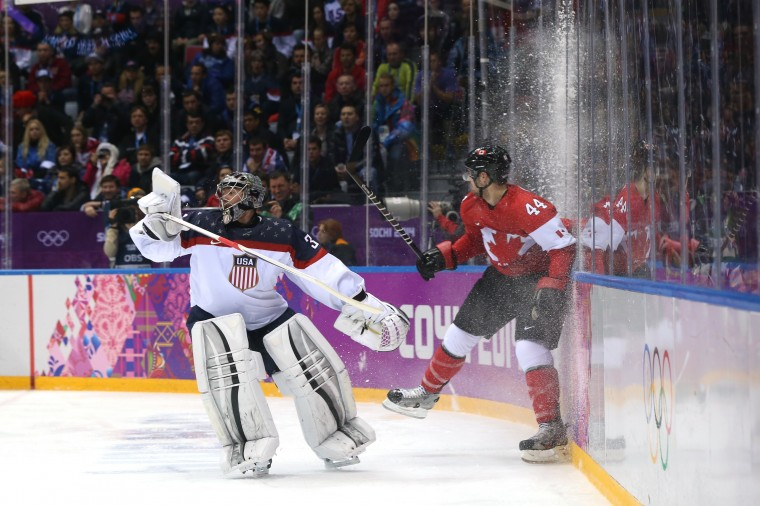 Marc-Edouard Vlasic #44 of Canada collides into the boards against Jonathan Quick #32 of the United States during the Men's Ice Hockey Semifinal Playoff on Day 14 of the 2014 Sochi Winter Olympics at Bolshoy Ice Dome on February 21, 2014 in Sochi, Russia. (Photo by Bruce Bennett/Getty Images)