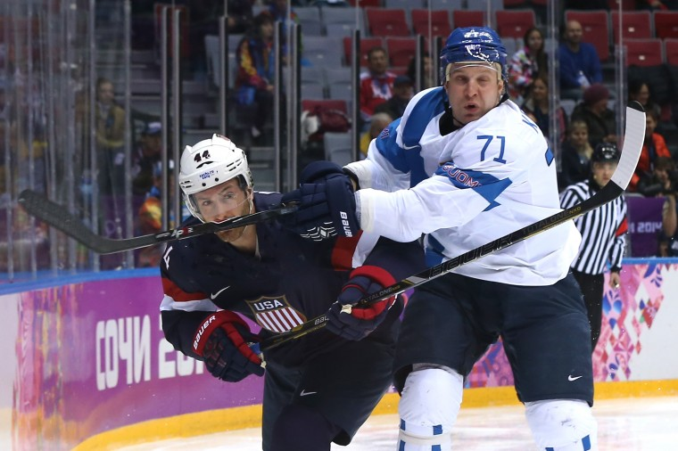 Leo Komarov #71 of Finland collides with Brooks Orpik #44 of the United States in the first period during the Men's Ice Hockey Bronze Medal Game on Day 15 of the 2014 Sochi Winter Olympics at Bolshoy Ice Dome on February 22, 2014 in Sochi, Russia. (Photo by Bruce Bennett/Getty Images)