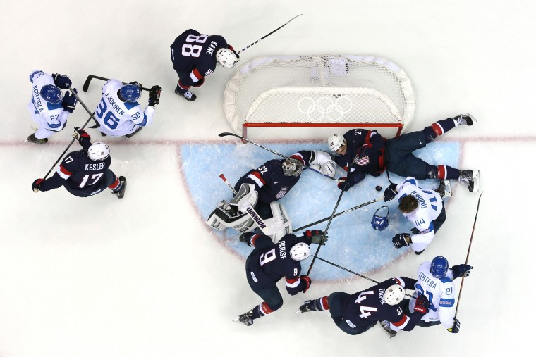 Kimmo Timonen #44 of Finland loses his helmet against Zach Parise #9, Jonathan Quick #32 and Ryan McDonagh #27 of the United States in the first period during the Men's Ice Hockey Bronze Medal Game on Day 15 of the 2014 Sochi Winter Olympics at Bolshoy Ice Dome on February 22, 2014 in Sochi, Russia. (Photo by Martin Rose/Getty Images)