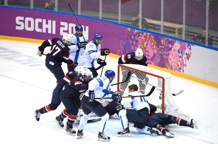Kimmo Timonen #44 of Finland loses his helmet against Zach Parise #9, Jonathan Quick #32 and Ryan McDonagh #27 of the United States in the first period during the Men's Ice Hockey Bronze Medal Game on Day 15 of the 2014 Sochi Winter Olympics at Bolshoy Ice Dome on February 22, 2014 in Sochi, Russia. (Photo by Lars Baron/Getty Images)