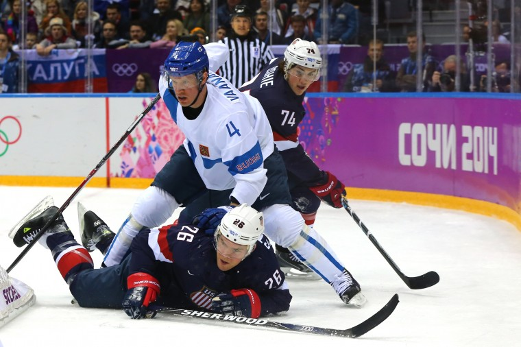 Ossi Vaananen #4 of Finland stands over Paul Stastny #26 of the United States in the first period during the Men's Ice Hockey Bronze Medal Game on Day 15 of the 2014 Sochi Winter Olympics at Bolshoy Ice Dome on February 22, 2014 in Sochi, Russia. (Photo by Martin Rose/Getty Images)