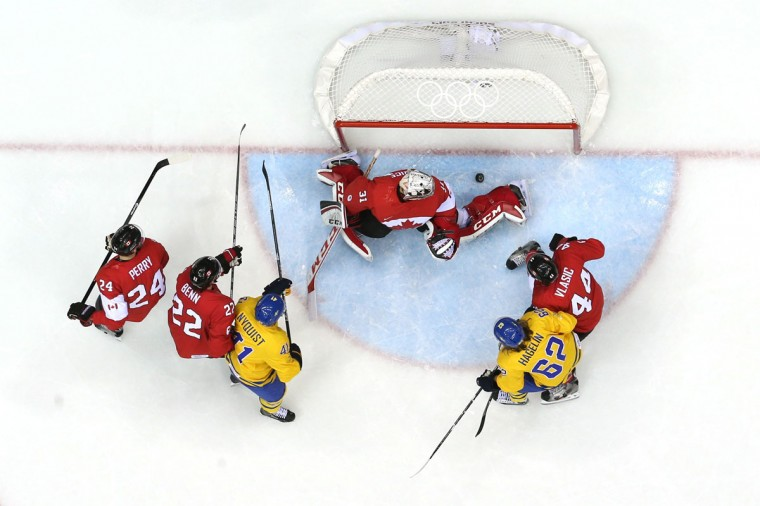 Carey Price of Canada makes a save against Gustav Nyquist and Carl Hagelin of Sweden. (Photo by Bruce Bennett/Getty Images)