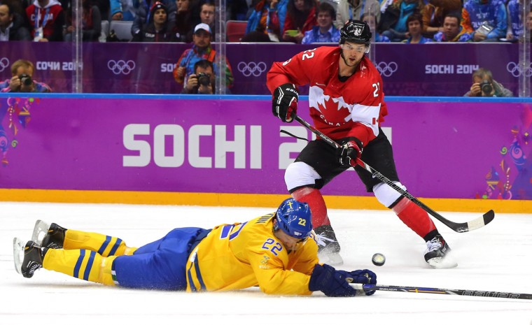 Jamie Benn of Canada has his shot on goal blocked by Daniel Sedin of Sweden. (Photo by Martin Rose/Getty Images)