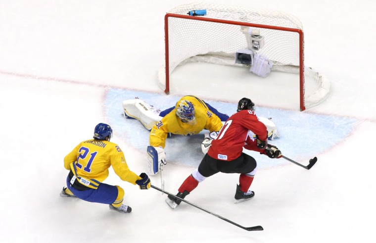 Sidney Crosby of Canada scores a goal against Henrik Lundqvist of Sweden. (Photo by Bruce Bennett/Getty Images)