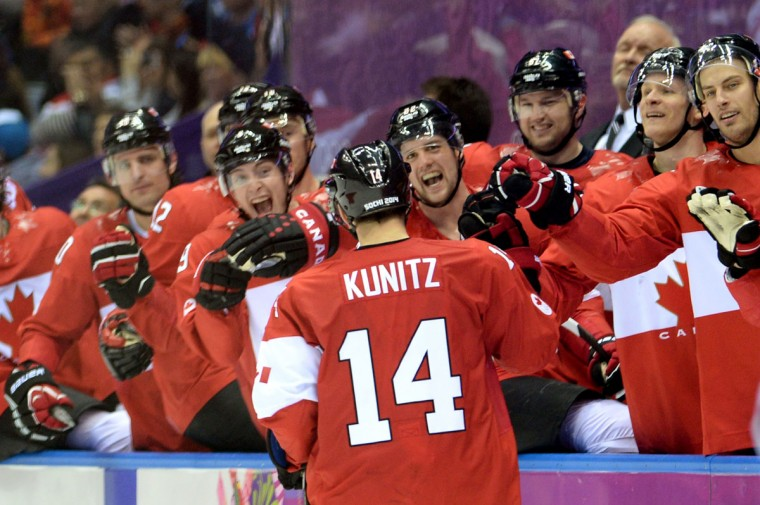 Chris Kunitz of Canada celebrates with teammates after scoring a third-period goal against Sweden (Photo by Harry How/Getty Images)
