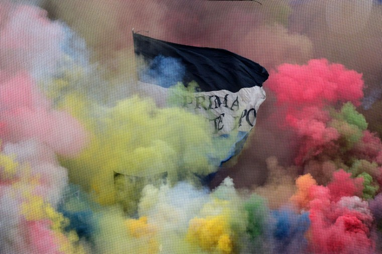 """Atalanta's supporters light fireworks during the Serie A soccer match between Atalanta vs Napoli at """"Azzurri D'Italia"""" Stadium in Bergamo on February 2, 2014. (Guiseppe Cacace/AFP/Getty Images)"""