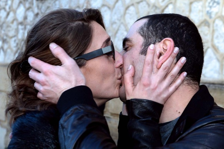 The former Georgian minister of Defence David Kezerachvili embraces his wife Sophia as he leaves the Baumettes prison in Marseille on February 3, 2014. The former Defence minister was freed and placed under house arrest with an electronic bracelet by an appeals court in Aix-en-Provence, as he awaits the court's February 27 ruling on the Georgian government's request for his extradition. || CREDIT: BORIS HORVAT - AFP/GETTY IMAGES