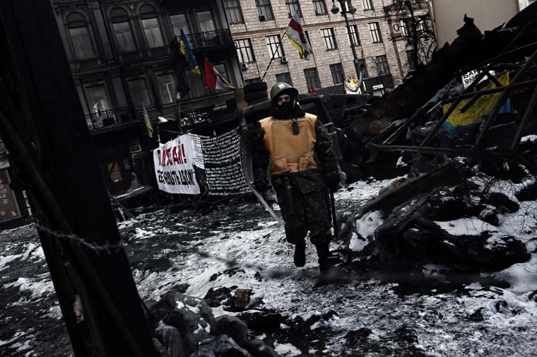 An anti-government protester walks at a road block in Kiev on February 3, 2014. Tens of thousands of protesters, buoyed by pledges of support from Europe and the United States, rallied in Ukraine on Sunday in a bid to wring new concessions from President Viktor Yanukovych. More than 50,000 people could be seen on Kiev's barricaded Independence Square -- that has become the epicentre of a two-month protest movement -- and thousands more were arriving. (Aris Messin/AFP/Getty Images)