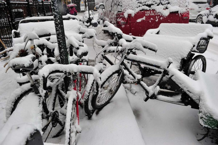Bicycles and pedicabs are covered with snow February 3, 2014 on the east side of Manhattan as a snowstorm hits New York. (Stan Honda /AFP/Getty Images)