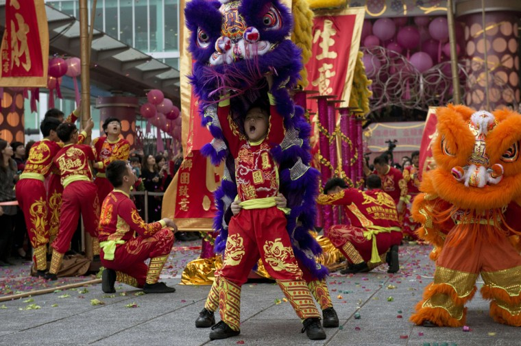 Performers take part in a traditional lion dance to celebrate the new Lunar Year of the Horse in Hong Kong on February 4, 2014. The lunar calendar is based on the cycles of the moon and through Chinese folklore ascribes 12 animals, one for each year in the rotating cycle. The horse is in the seventh position. (Alex Ogle/AFP/Getty Images)