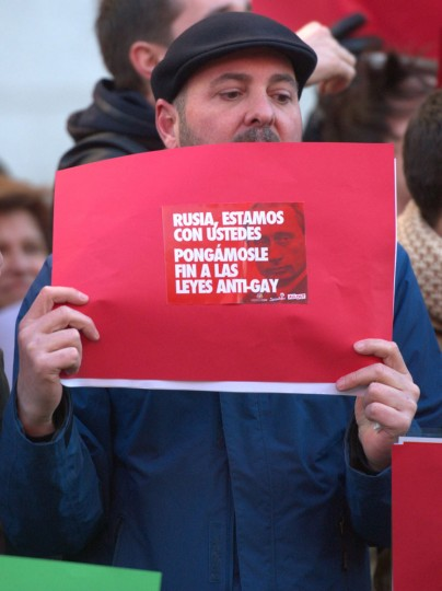 "A demonstrator holds a poster with that reads ""Russia we are with you, let's put an end to the anti-gay laws"" in Madrid on February 5, 2014 during a demonstration against anti-gay laws in Russia. (Curto de la Torre/AFP/Getty Images)"