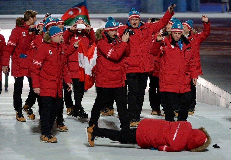 A member of Austria's delegation lies on the ground after falling during the Opening Ceremony of the Sochi Winter Olympics at the Fisht Olympic Stadium on February 7, 2014 in Sochi. (Andrej Isakovic/AFP/Getty Images)