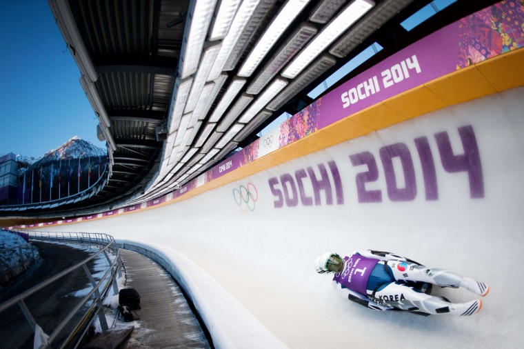 South Korea's Park Jinyong and Cho Jung Myung during a Luge Doubles training session at the Sanki Sliding Centre in Rosa Khutor on February 8, 2014, during the Sochi Winter Olympics. (Leon Neal/AFP/Getty Images)