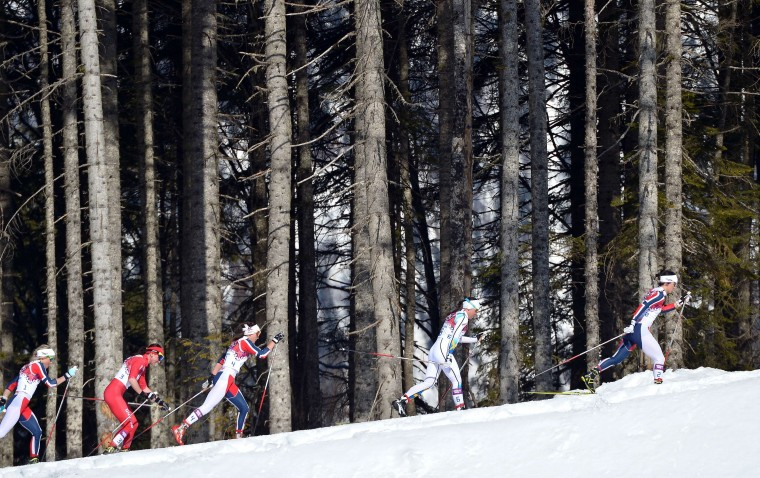 Norway's Marit Bjoergen (R) competes in the Women's Cross-Country Skiing 7,5km + 7,5km Skiathlon at the Laura Cross-Country Ski and Biathlon Center during the Sochi Winter Olympics on February 8, 2014 in Rosa Khutor. (Alberto Pizzoli/AFP/Getty Images)