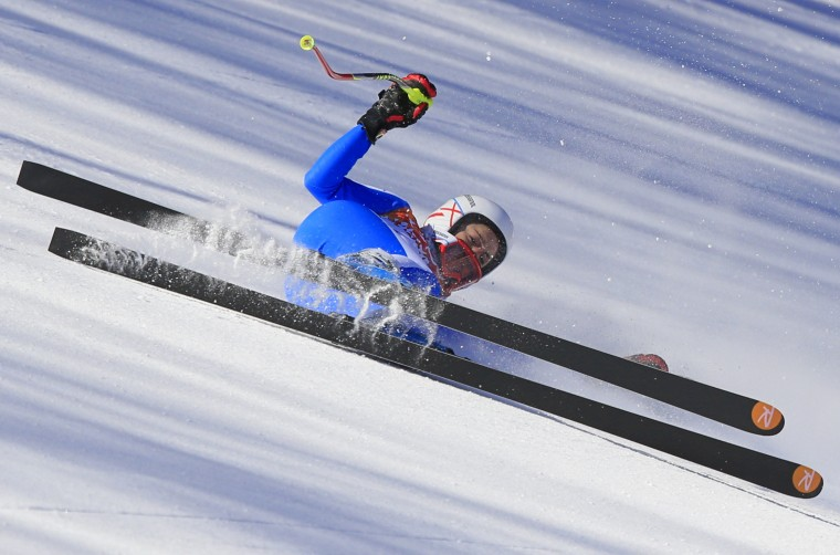 Italy's Federica Brignone falls during a Women's Alpine Skiing Downhill training session at the Rosa Khutor Alpine Center on February 8, 2014, during the Sochi Winter Olympics. (Alexander Klein/AFP/Getty Images)