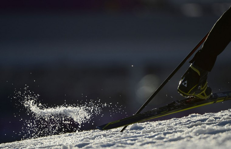 Snow is pushed away as an athlete competes in the Men's Biathlon 10 km Sprint at the Laura Cross-Country Ski and Biathlon Center during the Sochi Winter Olympics on February 8, 2014 in Rosa Khutor. (Pierre-Philippe Marcou/AFP/Getty Images)