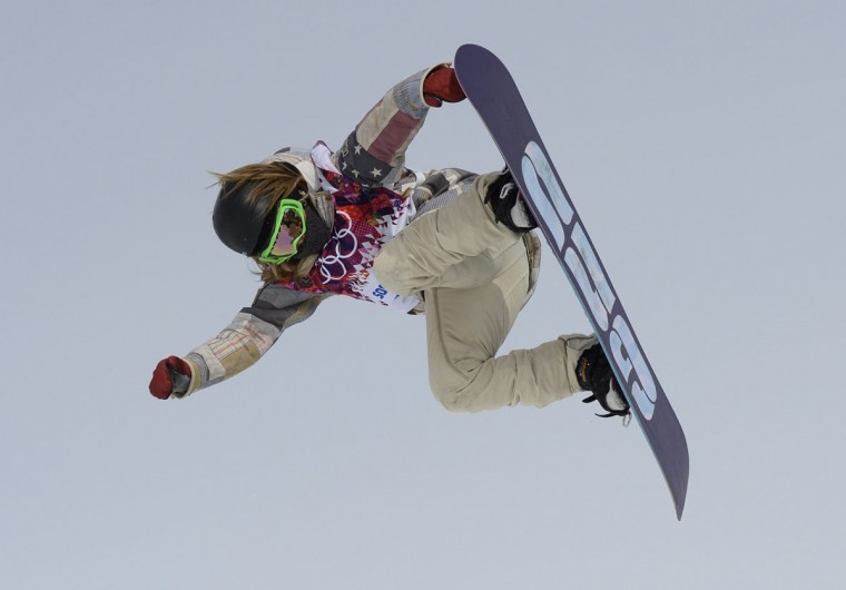 U.S. snowboarder Jamie Anderson competes in the women's snowboard slopestyle final at the Rosa Khutor Extreme Park during the Sochi Winter Olympics on February 9, 2014. Anderson won the gold medal, giving the U.S. a gold-medal sweep of the slopestyle event. (Franck Fife/AFP/Getty Images)
