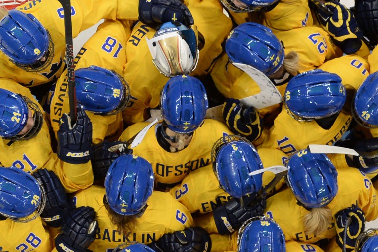 Sweden's players celebrate after winning the women's ice hockey Group B match against Japan at the Shayba Arena during the Sochi Winter Olympics on February 9, 2014. (Andrej Isakovic/AFP/Getty Images)