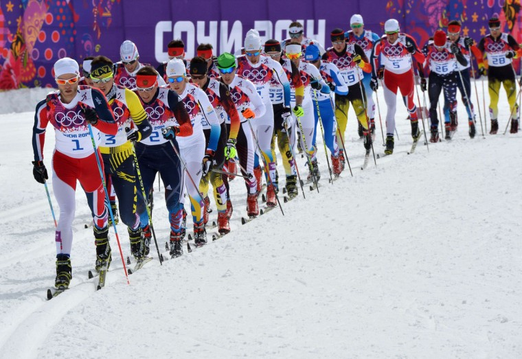 Norway's Martin Johnsrud Sundby (left) leads the pack in the men's cross-country skiing 15km + 15km skiathlon during the Sochi Winter Olympics on February 9, 2014, in Rosa Khutor. (Alberto Pizzoli/AFP/Getty Images)