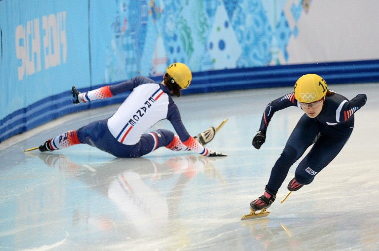 France's Veronique Pierron (L) falls as she competes next to South Korea's Park Seunghi in the Women's Short Track 500 m Heats at the Iceberg Skating Palace during the Sochi Winter Olympics on February 10, 2014. (Yuri Kadobnov/AFP/Getty Images)