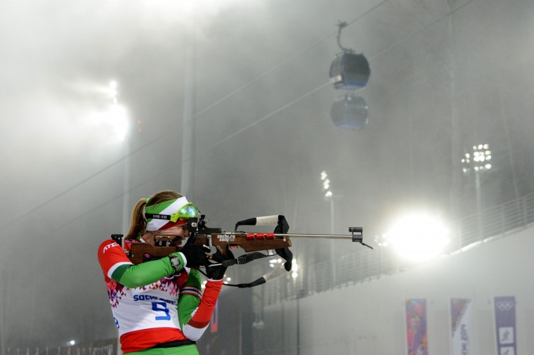 Belarus' Darya Domracheva shoots at the range as they compete in the Women's Biathlon 10 km Pursuit at the Laura Cross-Country Ski and Biathlon Center during the Sochi Winter Olympics on February 11, 2014 in Rosa Khutor near Sochi . (Kirill/AFP/Getty Images)