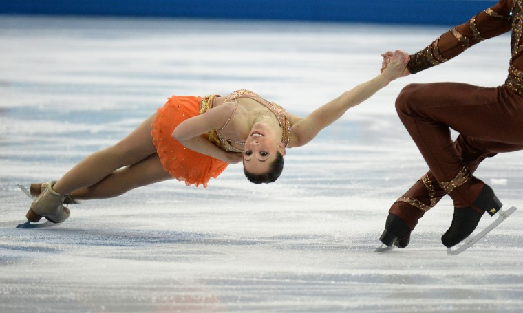 Italy's Nicole Della Monica and Italy's Matteo Guarise fall in the Figure Skating Pairs Short Program at the Iceberg Skating Palace during the 2014 Sochi Winter Olympics on February 11, 2014. (Yuri Kadobnov/AFP/Getty Images)