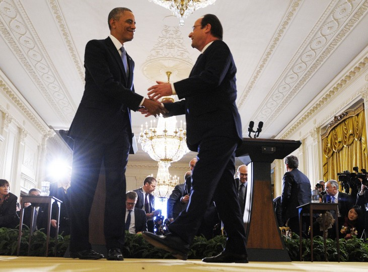 President Barack Obama shakes hands with French President Francois Hollande during a joint press conference following their meetings in the East Room at the White House in Washington, DC, on February 11, 2014. Hollande's three-day state visit to the US, which is designed to underscore historic ties and a burgeoning security relationship between America and its oldest ally, takes place as he tries to shrug off embarrassment over his love life. (Jewel Samad/AFP/Getty Images)