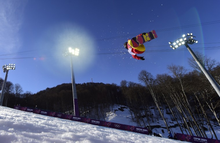 China's Cai Xuetong competes in the Women's Snowboard Halfpipe Qualifications at the Rosa Khutor Extreme Park during the Sochi Winter Olympics on February 12, 2014. (Javier Soriano/AFP/Getty Images)
