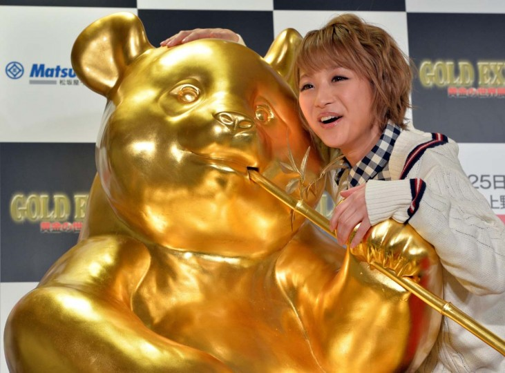 Japanese model Nana Suzuki hugs a life-sized gold panda which is made from fiber rainforced plastic (FRP) and coated with gold foil at the opening of the Gold Expo at Tokyo's Matsuzakaya department store on February 13, 2014. The 100 cm tall panda figure is on sale with a price of 8.88 million yen (88,000 USD), and the gold products exhibition will be held through February 25. || CREDIT: YOSHIKAZU TSUNO - AFP/GETTY IMAGES
