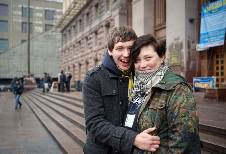 Yaroslava (R), 21, Stas, 18, pose for a photo in front of Kiev's city hall on February 13, 2014. Both are members of self-defence groups that defend Kiev's Independence Square, which has been occupied by anti-government protesters for nearly three months, and plan to get married on February 26, 2014. || PHOTO CREDIT: GENYA SAVILOV - AFP/GETTY IMAGES