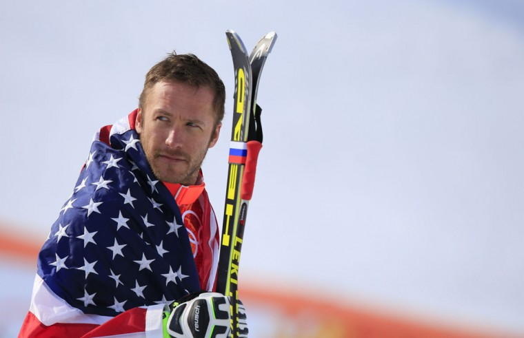 Bronze medalist U.S. skier Bode Miller arrives on the podium during the men's alpine skiing Super-G flower ceremony at the Rosa Khutor Alpine Center during the Sochi Winter Olympics on February 16, 2014. (Alexander Klein/AFP/Getty Images)