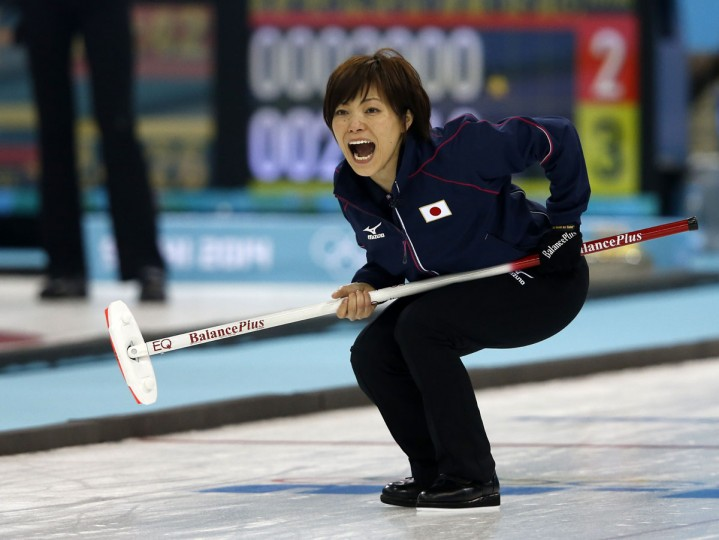 Japan's skip Ayumi Ogasawara (center) reacts to a throw during the women's curling round robin session 10 match between Japan and Switzerland at the Ice Cube curling centre in Sochi on February 16, 2014 during the 2014 Sochi winter Olympics. (Adrian Dennis/AFP/Getty Images)