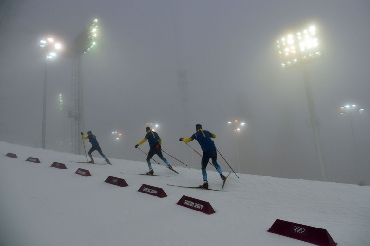 Members of the Swedish team test the track as the men's biathlon 15-km race's mass start gets delayed due to a heavy fog at the Laura Cross-Country Ski and Biathlon Center during the Sochi Winter Olympics on February 16, 2014, in Rosa Khutor, near Sochi. (Alberto Pizzoli/AFP/Getty Images)
