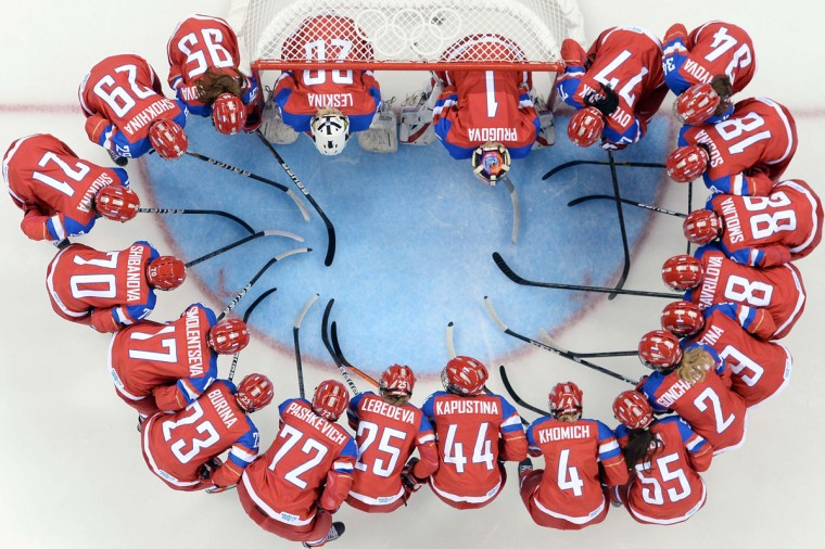 Russia's players gather before the start of the women's ice hockey classifications (5-8) match at the Shayba Arena during the Sochi Winter Olympics on February 16, 2014. (Jonathan Nackstrand/AFP/Getty Images)