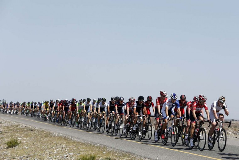 Cyclists ride through the desert during the first stage of the Tour of Oman, 168.5 km from al-Suwaiq Fort to al-Naseem Park in the North Batna province, north of the capital Muscat, on February 18, 2014. The fifth edition of the Tour of Oman is a hilly six-stage event, with the main climb coming on the weekend which has a steep mountaintop finish. (mohammed MahjoubAFP/Getty Images)