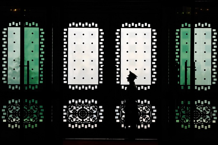 A People's Liberation Army guard stands in front of doors during US Army Chief of Staff General Ray Odierno meeting with Fan Changlong, Deputy Chaiman of the Central Military Commission at Bayi Building in Beijing on February 21, 2014. (Lintao Zhang/AFP/Getty Images)