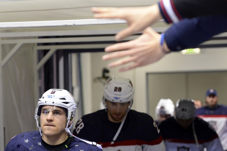 US Zach Parise and teammates enters the pitch before the Men's Ice Hockey Semifinal match between the USA and Canada at the Bolshoy Ice Dome during the Sochi Winter Olympics on February 21, 2014. (Jonathan Nackstrand/AFP/Getty Images)