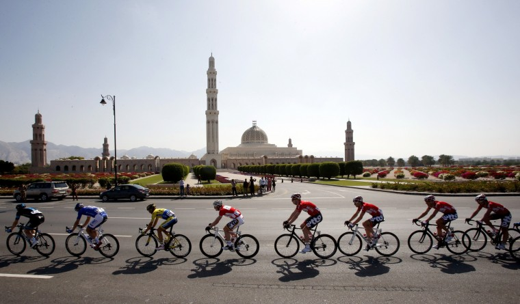 Cyclists ride their bikes during the 173-kilometre fourth stage of the Oman cycling tour on February 21, 2014 between Wadi Al Abiyad and Muscat. Slovakia's Peter Sagan, who inherits the leader's red jersey from Andre Greipel, prevailed in a sprint from Rigoberto Uran of Colombia and Italian rider Vincenzo Nibali. (Mohammed Mahjoub/AFP/Getty Images)