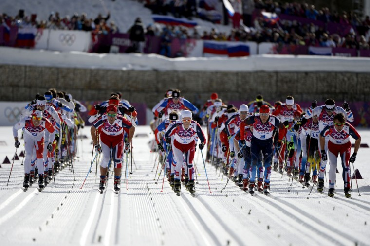 Athletes gather at the strat of the Men's Cross-Country Skiing 50km Mass Start Free. (PIERRE-PHILIPPE MARCOU/AFP/Getty Images)